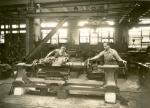 Men working in repair shop.'