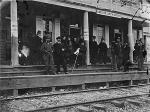 Image of passengers standing on the porch of Hanover Station