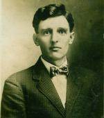 A photograph of Rosenkrans wearing a suit jacket, white shirt, and bowtie.