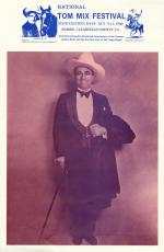 Tom Mix dress in tuxedo, bow tie, cowboy hat, and carrying a cane. A coat is draped over his left arm.