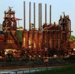 Color photograph of abandoned Duquesne blast furnaces.