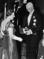 King Gustav of Sweden is shown presenting the Nobel Prize for Literature to Pearl Buck.