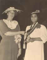 Image of Marian Anderson wearing the Spingarn medal with Eleanor Roosevelt standing beside her.