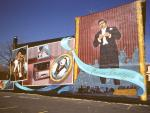 """Suggesting a page in a fan's scrapbook, the Mario Lanza Mural at Broad and Reed Streets fuses a variety of images and artifacts to capture this south Philadelphia Natives versatile career as a singer, movie idol, and classical performer."""