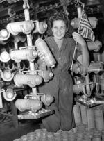 Florence McMillan, a worker at the Budd Mfg. Co., surrounded by 20-pound fragmentation bombs manufactured for the U.S. Army.'