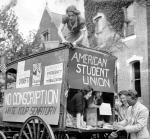 Members of the American Students Union drove this wagon to college campuses in the Philadelphia area to sign up young men opposed to compulsory military service.  Pictured here at the Penn campus.