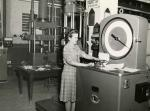Photograph of a female employee conducting a test.'