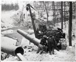 "Pipeliners laying the ""Big Inch"" oil line at Brandywine Creek near Glen Moore, PA, winter, 1943."