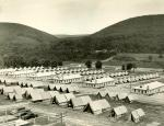 Rows of tents and brick buildings. The gap for which the reservation is named can be seen in the background
