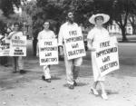 Bayard Rustin, with other marchers, wearing a sign that reads Free Imprisoned War Objectors