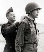 Black and white image of soldier receiving Medal of Honor from a General.