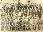 Pottstown Ironworker crew, c. 1861, consisting of Nailers, Heaters, Feeders and Forgers. Notice the tools that the workers hold and the row of children in the top rows.